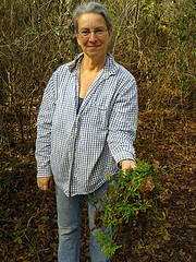 Gretchen with uprooted Japanese climbing fern